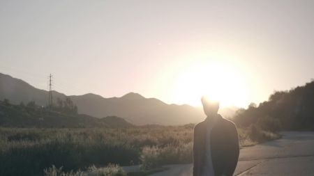 Hoodie Allen hitchhikes through heartache in 'Dumb for You' music video