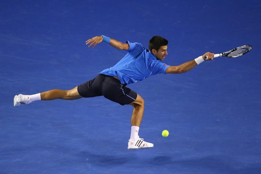Djokovic holds off Mueller in straight sets