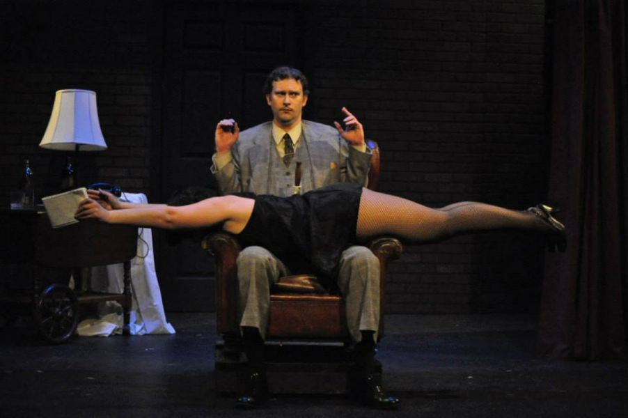 "(Top to Bottom) BRYAN BENDER (Richard Hannay) and DEYA OZBURN (The Woman) from the Lakewood Playhouse Production of ""THE 39 STEPS"""