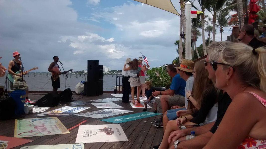 "Everyone is having fun at the Rockin' Riverwalk stage in Downtown Stuart as ""Making Faces"" performs."