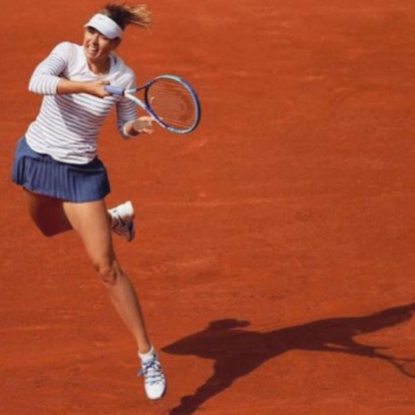 Maria Sharapova extends her body to return a shot in her opening round Monday