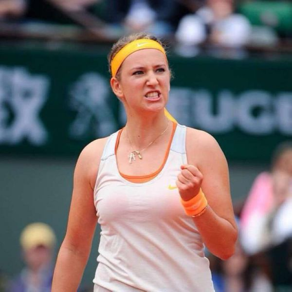 Victoria Azarenka clenches her fist in a well deserved first round win at Roland Garros