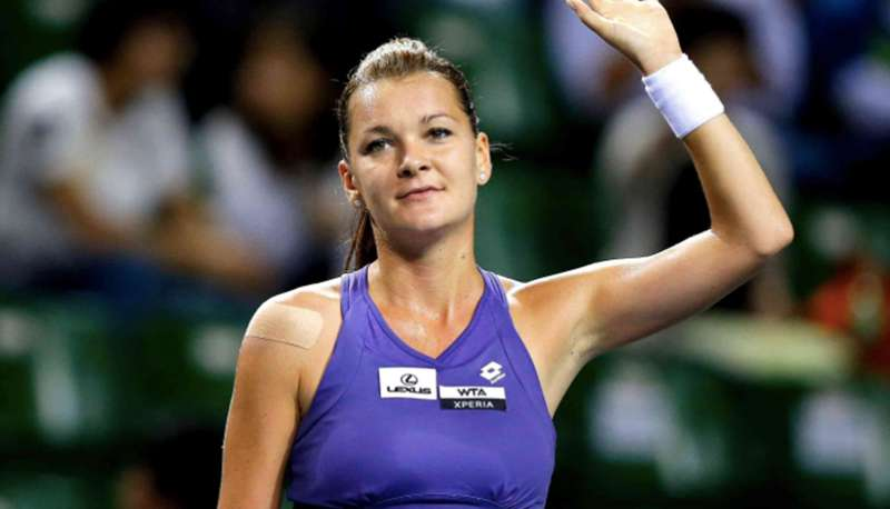 Poland's Agnieszka Radwanska waves to the crowd after winning her second round match in Madrid