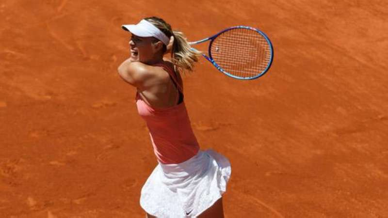 Maria Sharapova slams the ball across the court during her second round win at the Madrid Open.