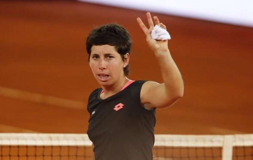 Spanish tennis star Carla Suarez-Navarro waves to the home crowd after winning her second round match.