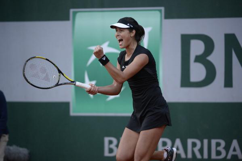 Ana Ivanovic pumps her fist after winning her third round match at the French Open