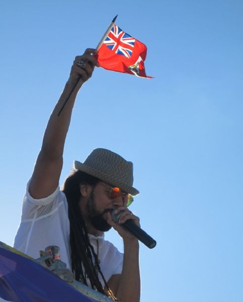 Kes waves a Bermuda flag as he talks to the Bermuda's Parade crowd from the Cell One Truck.