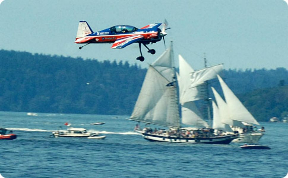 The air show meets the sailboats on Commencement Bay up close during the Tacoma Freedom Fair.
