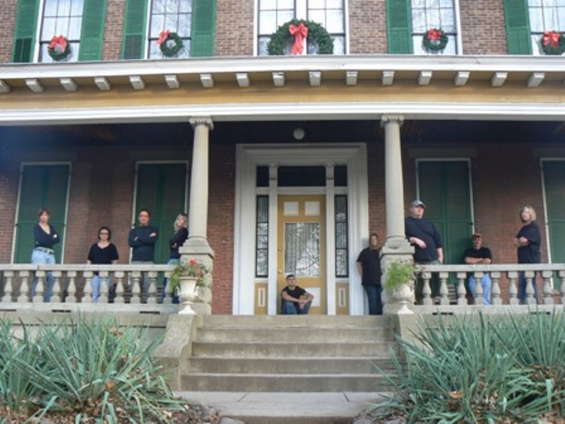 The authors former paranormal investigative team poses for a group photo on the front porch of the Hannah House. (The author is on the right