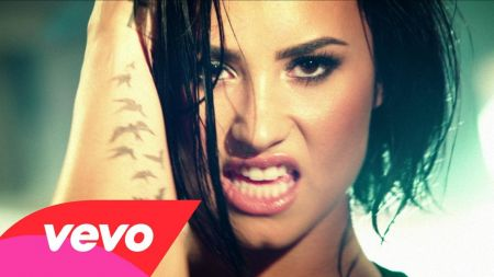 Demi Lovato battles it out with Michelle Rodriguez in 'Confident' music video