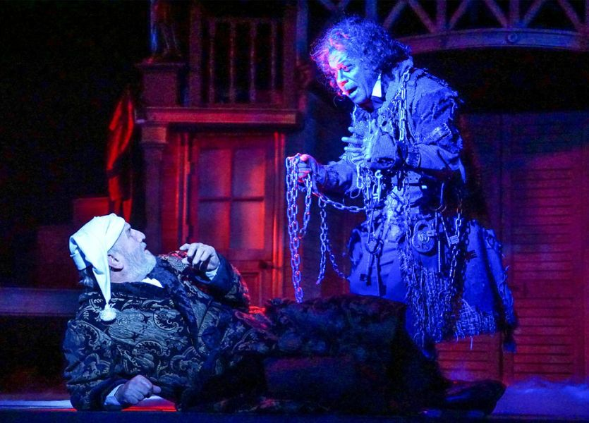 "Jacob Marley threatens Ebenezer Scrooge in ""A Christmas Carol"" at KCRep"