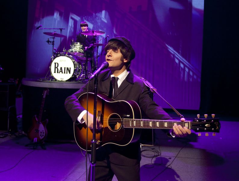 Jim Irizarry as John Lennon