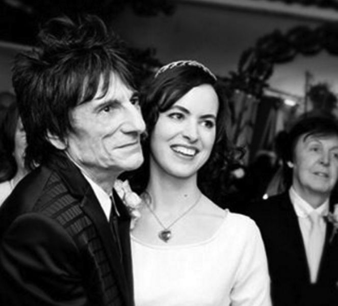 Ronnie and Sally Wood, and what appears to be a photobombing Paul McCartney