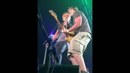 Keith Urban lets birthday boy play his guitar, fan then steals the show (video)