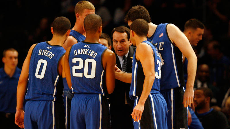 Duke head coach Mike Krzyzewski (center) is caught in the middle of a North Carolina controversy after Albany cancels its game in Raleigh ov
