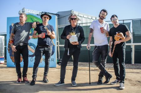 Collective Soul present their Claw game winnings at San Diego's KAABOO Del Mar Festival.