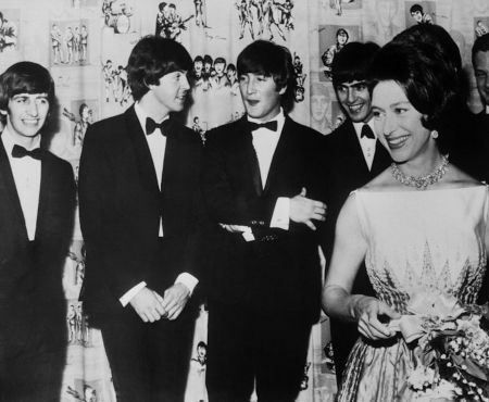 The Beatles (L) all received MBE medals in October 1965 from Queen Elizabeth (R).