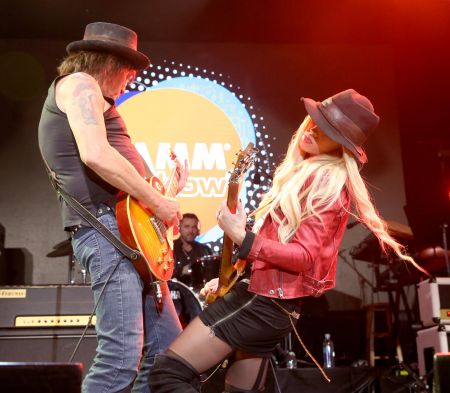 ANAHEIM, CA - JANUARY 19. Guitarists Richie Sambora and Orianthi of RSO perform onstage during the 2017 NAMM Show Opening Day at Anaheim Con