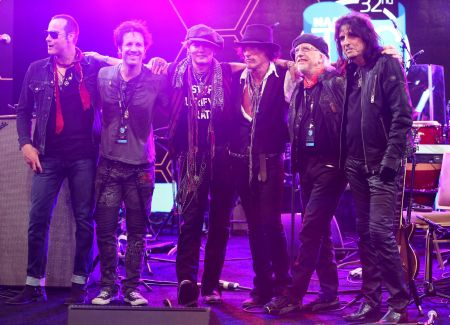 ANAHEIM, CA - JANUARY  21: Johnny Depp, Brad Whitford and Alice Cooper rock out with Les Paul Award recipient Joe Perry, at the  2017 NAMM T