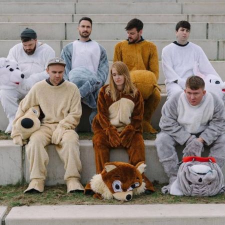 <p>Los Campesinos! band members pose in sport mascot costumes.</p>